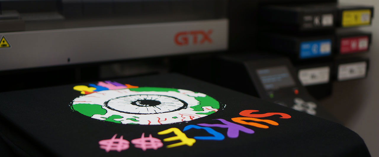 close-up of a full-color t-shirt being printed on a direct to garment printer