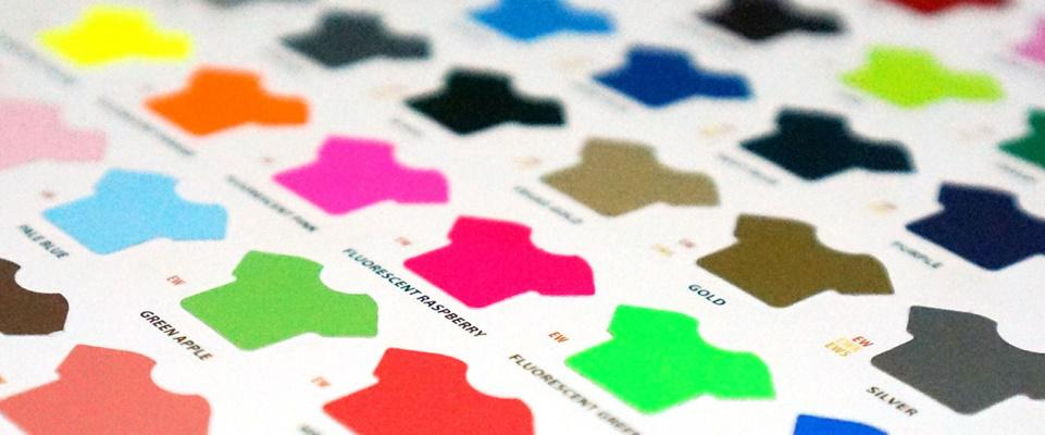 close-up of a vinyl color selection book, featuring fluorescent colors