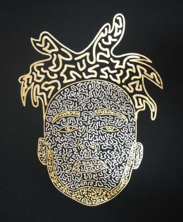 an example of a vinyl printed black shirt using gold and silver foil to make a face design