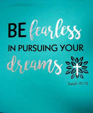 an example of a vinyl printed teal shirt with the message 'be fearless in pursuing your dreams Isaiah 41:13' using black and silver foil vinyl