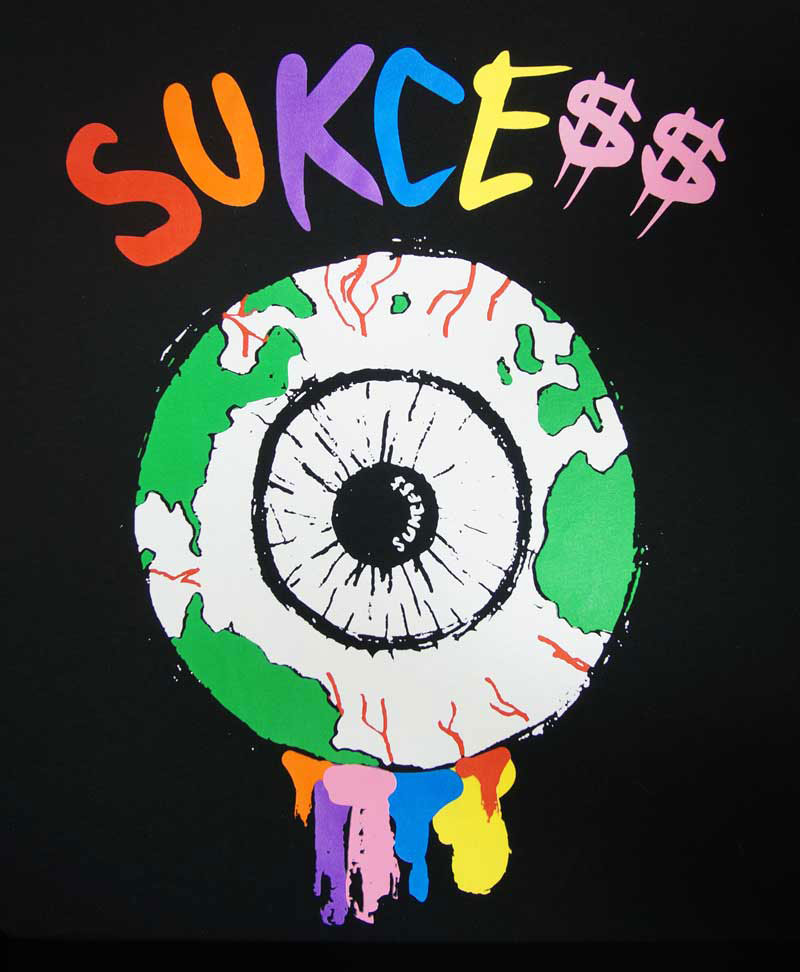 an example of a DTG-printed black shirt with an eye ball colored like a globe and the text 'SUKCE$$'