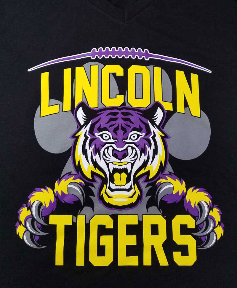 an example of a DTG-printed black shirt of an illustrated lion mascot for the 'Lincoln Tigers'
