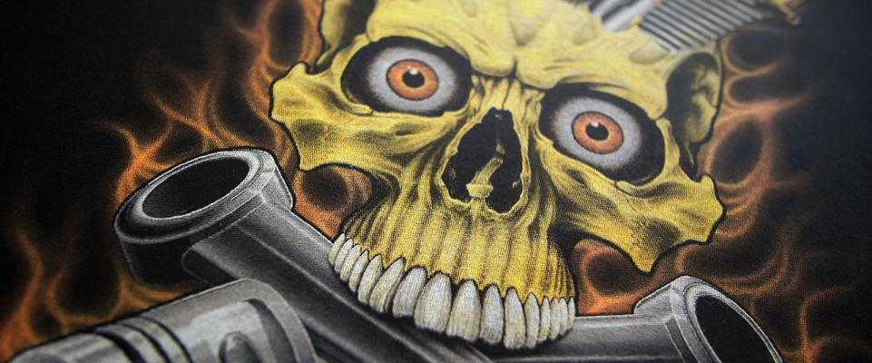 close-up of a full-color simulated process screen print of a burning skull