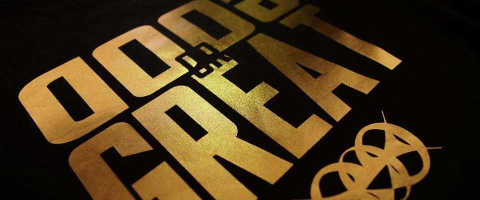 close-up of a gold foil printed t-shirt saying 'Good or Great'