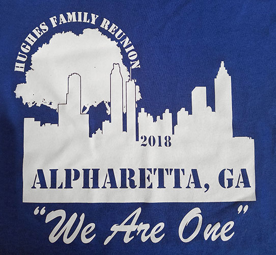 Custom family reunion shirt design - blue shirt with white silhouette of city skyline and tree
