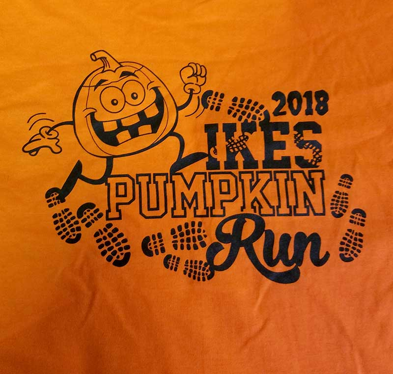 custom orange shirt - 1-color black screen printed pumpkin run design